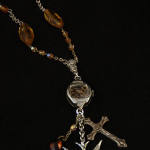 Image of steampunk necklace with bird, cross, beads and watch parts by Jennifer Campbell