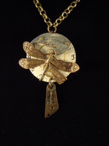 Image of steampunk pendant with dragonfly, key and watch face by Jennifer Campbell