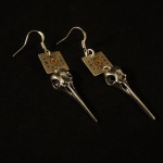 Steampunk earrings with watch parts and skulls by Jennifer Campbell
