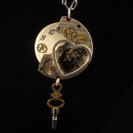 Image of a steampunk pendant with watch parts, heart, photo and old key by Jennifer Campbell