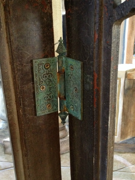 Brass hinges with verdigris finish
