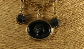 Detail of black cameo necklace