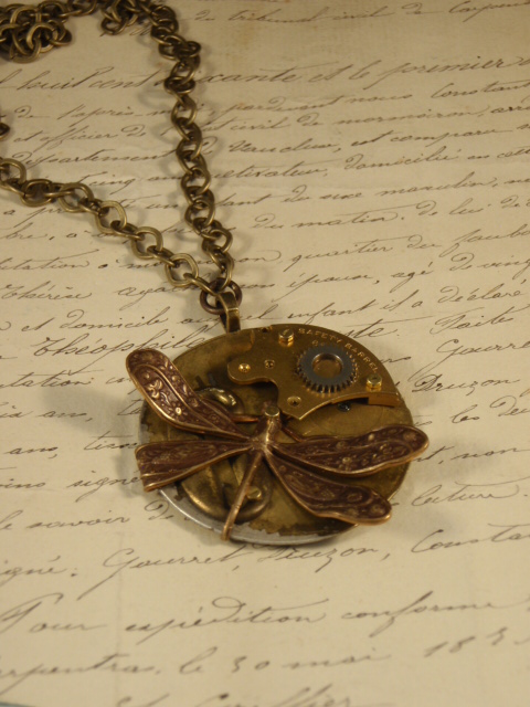 Vintage Treasure Necklace titled six with dragonfly and gears by Jennifer Campbell
