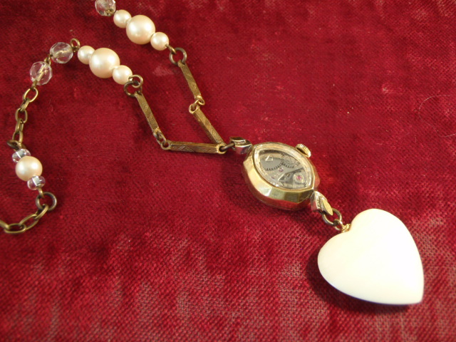 Image of Art Deco Necklace The Watched Heart on a red background