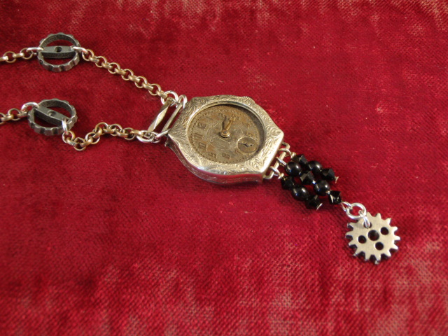 Image of Victorian Watch Art Deco Necklace on a red background